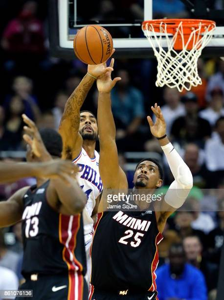 James Michael McAdoo of the Philadelphia 76ers battles Jordan Mickey of the Miami Heat for a rebound during the game at Sprint Center on October 13...