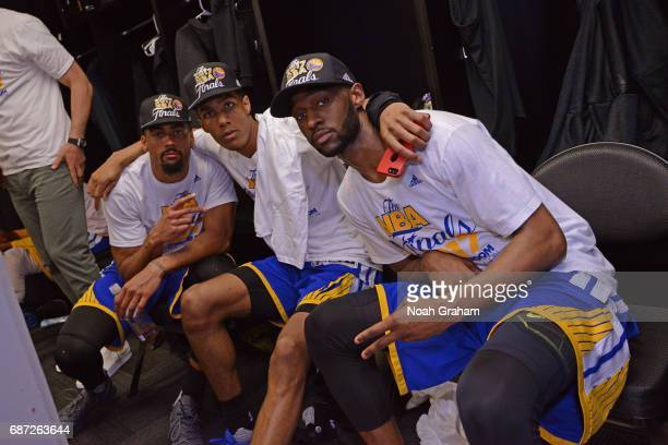 James Michael McAdoo Patrick McCaw and Ian Clark of the Golden State Warriors pose for a photo after winning Game Four of the Western Conference...