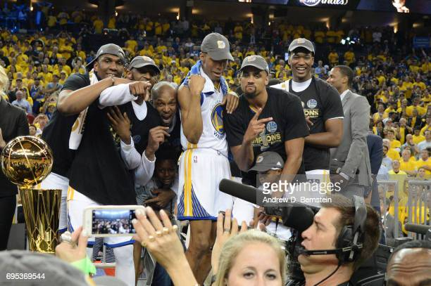 James Michael McAdoo Patrick McCaw Ian Clark and David West of the Golden State Warriors celebrate after winning the 2017 NBA Finals on June 12 2017...