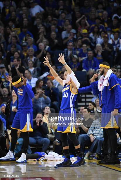 James Michael McAdoo Stephen Curry and JaVale McGee of the Golden State Warriors celebrates on the bench after Klay Thompson hits a threepoint shot...