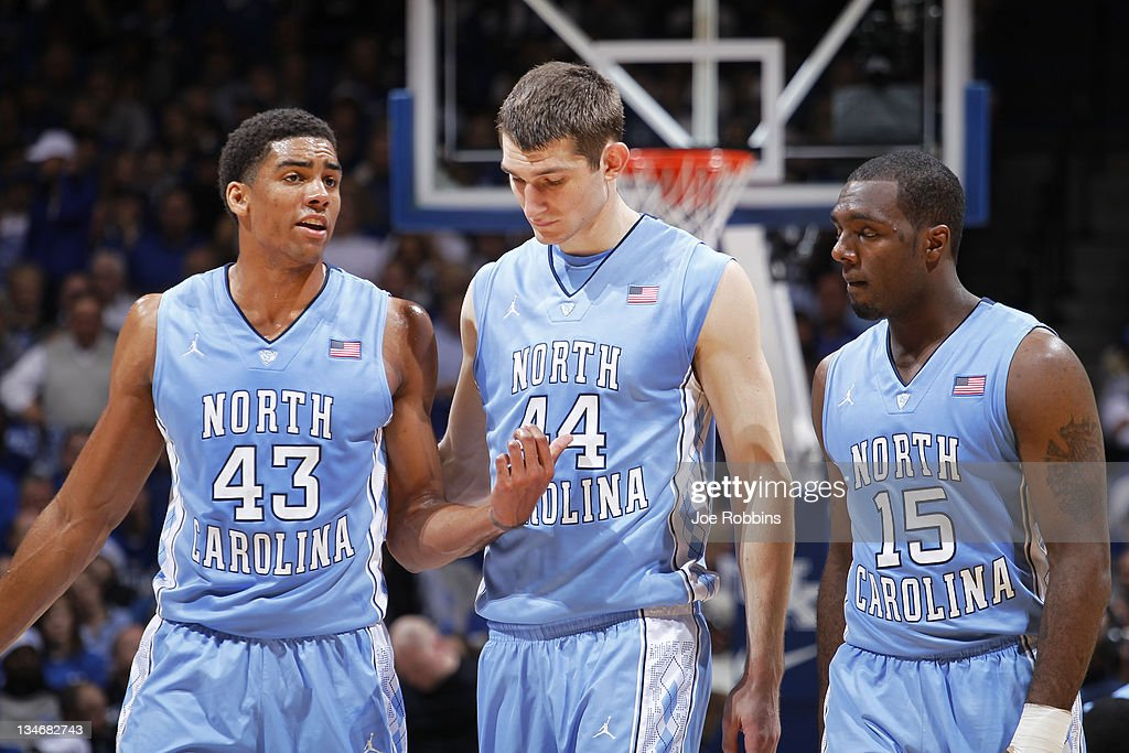 James Michael McAdoo #43, Tyler Zeller #44 and P.J. Hairston #15 of the North Carolina Tar Heels talk over strategy during the game against the Kentucky Wildcats at Rupp Arena on December 3, 2011 in Lexington, Kentucky. Kentucky won 73-72.