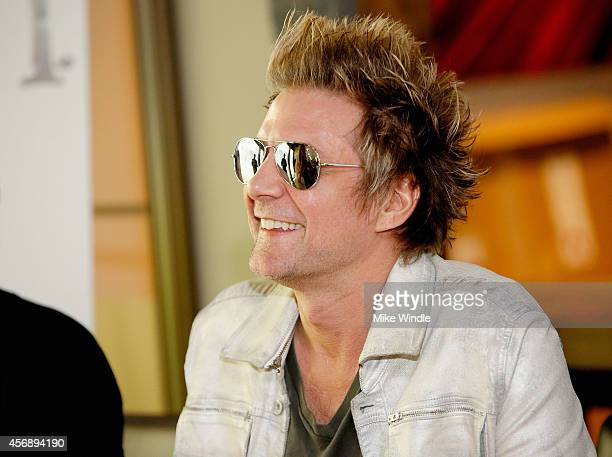 James Michael of SIXXAM signs copies of their new album Modern Vintage at firstever instore appearance at Best Buy on October 8 2014 in Burbank...