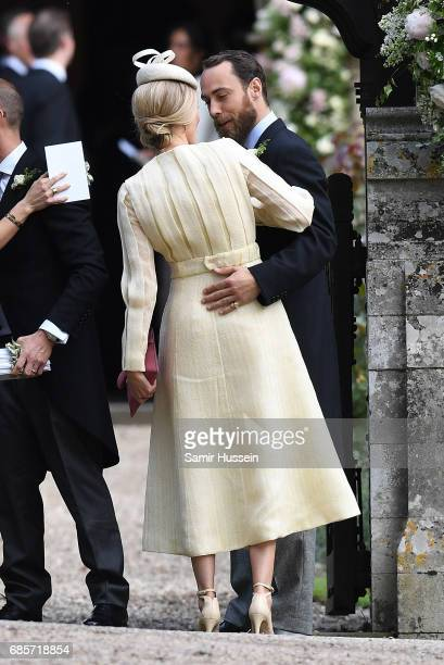 James Middleton greets Donna Air as she attends the wedding of Pippa Middleton and James Matthews at St Mark's Church on May 20 2017 in Englefield...