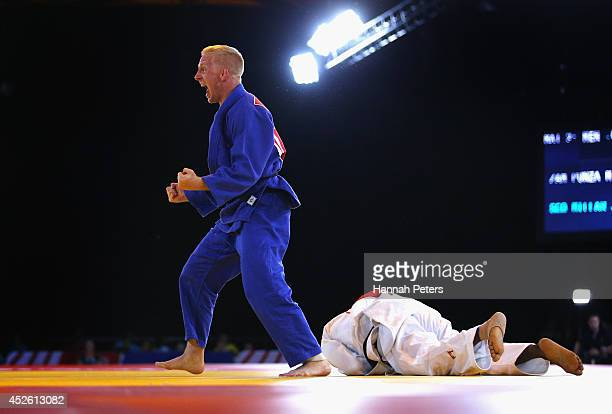 James Millar of Scotland celebrates victory in the Men's 66kg Bronze medal contest against Mathews Punza of Zambia at SECC Precinct during day one of...