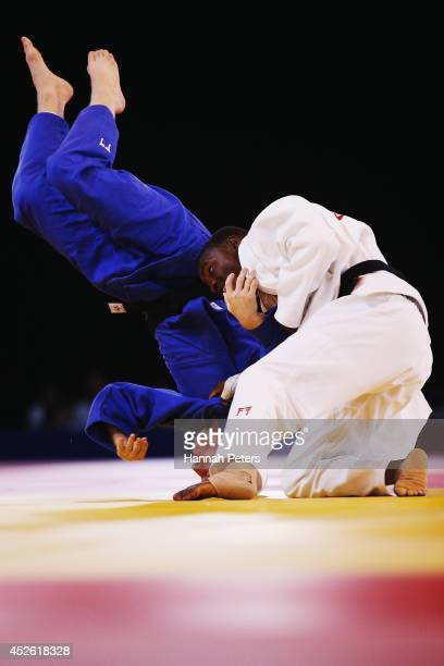 James Millar of Scotland competes against Mathews Punza of Zambia in the Men's 66kg Bronze medal match at SECC Precinct during day one of the Glasgow...