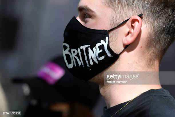James Miller from Los Angeles gathers with supporters of Britney Spears outside a courthouse in downtown for a #FreeBritney protest as a hearing...