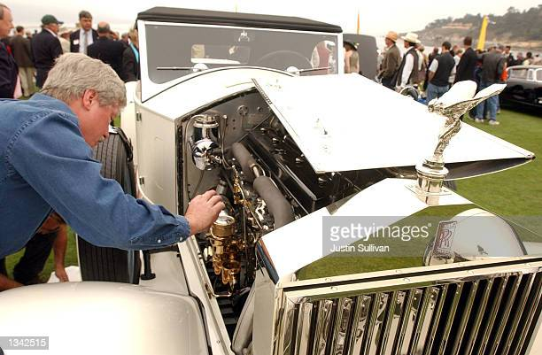 James Mills works on his 1927 Rolls Royce at the 2002 Pebble Beach Concours d'Elegance August 18, 2002 in Pebble Beach, California. The Pebble Beach...