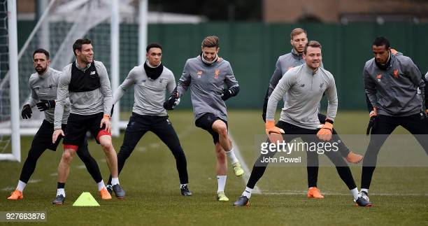 James Milner Adam Lallana Danny Ings Trent AlexanderArnold Ragnar Klavan Simon Mignolet and Joel Matip of Liverpool during a training session at...