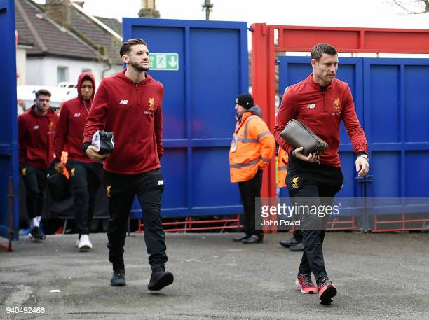 James Milner and Adam Lallana of Liverpool arrive before the Premier League match between Crystal Palace and Liverpool at Selhurst Park on March 31...