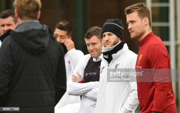 James Milner and Adam Lallana of Liverpool during a training session at Melwood Training Ground on March 29 2018 in Liverpool England