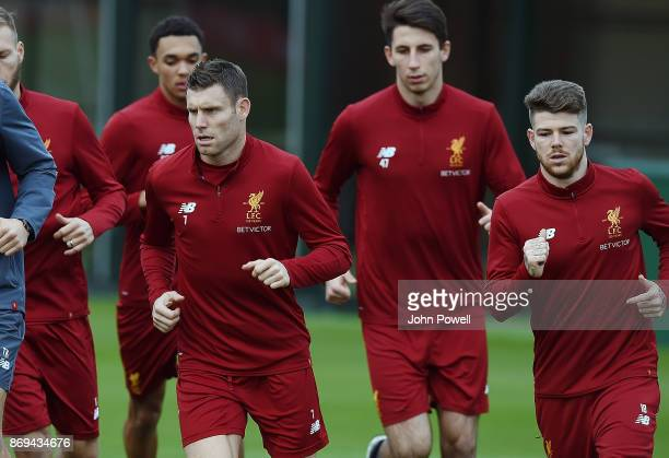 James Milner and Alberto Moreno of Liverpool during a training session at Melwood Training Ground on November 2 2017 in Liverpool England