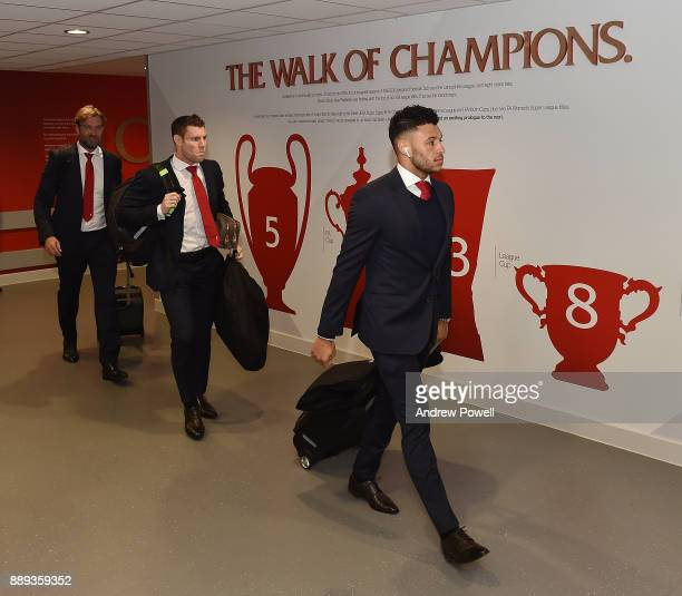 James Milner and Alex OxladeChamberlain of Liverpool arrives before the Premier League match between Liverpool and Everton at Anfield on December 10...