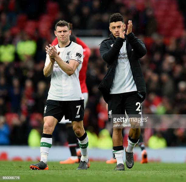 James Milner and Alex OxladeChamberlain of Liverpool shows their appreciation to the fans at the end of the Premier League match between Manchester...