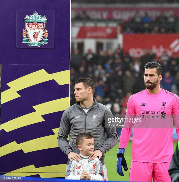 James Milner and Alisson Becker of Liverpool during the Premier League match between AFC Bournemouth and Liverpool FC at Vitality Stadium on December...