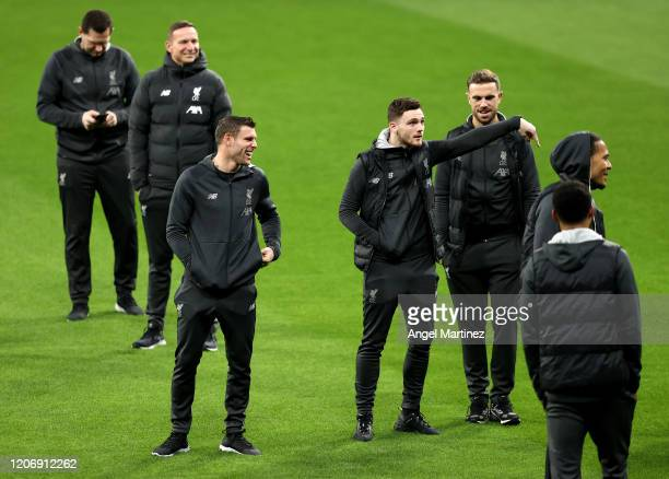 James Milner and Andrew Robertson in conversation as Liverpool players walk around the pitch prior to a press conference at Wanda Metropolitano on...