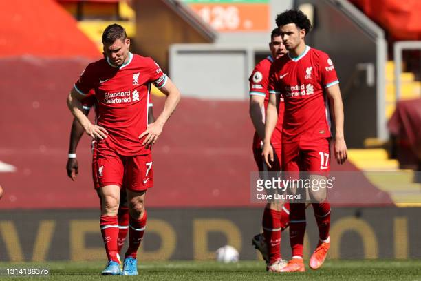 James Milner and Curtis Jones of Liverpool react after the Premier League match between Liverpool and Newcastle United at Anfield on April 24, 2021...