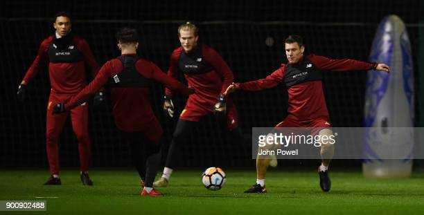 James Milner and Danny Ings of Liverpool during a training session at Melwood Training Ground on January 3 2018 in Liverpool England