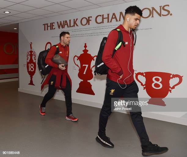 James Milner and Dominic Solanke of Liverpool arrives before The Emirates FA Cup Third Round match between Liverpool and Everton at Anfield on...