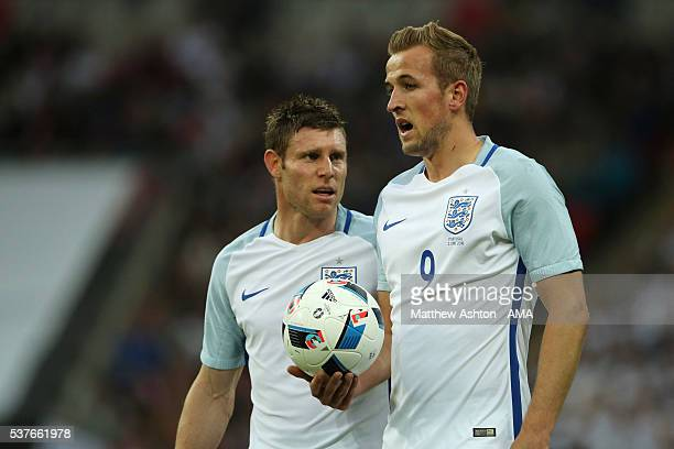James Milner and Harry Kane of England during the International Friendly match between England and Portugal at Wembley Stadium on June 2 2016 in...
