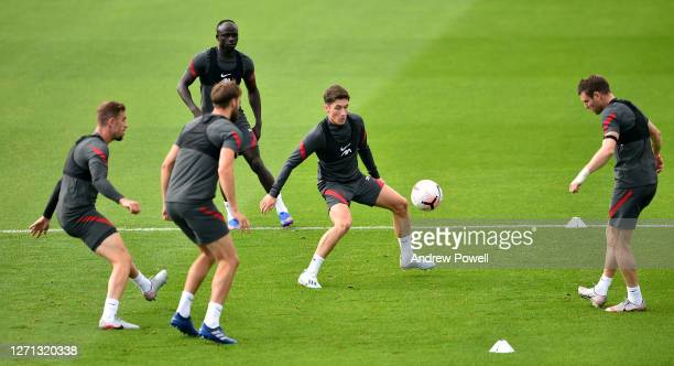 James Milner and Harry Wilson of Liverpool during a training session at Melwood Training Ground on September 08 2020 in Liverpool England