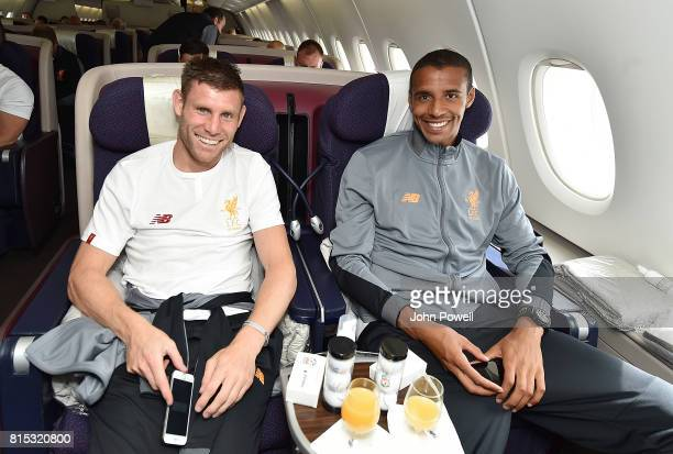 James Milner and Joel Matip of Liverpool on the plane before pre season tour at Manchester Airport on July 16 2017 in Liverpool England