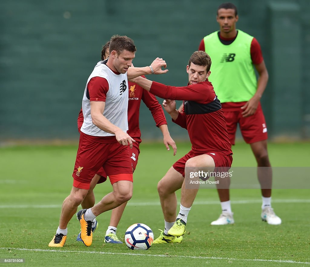 James Milner and Jon Flanagan of Liverpool during a training session at Melwood Training Ground on September 7, 2017 in Liverpool, England.