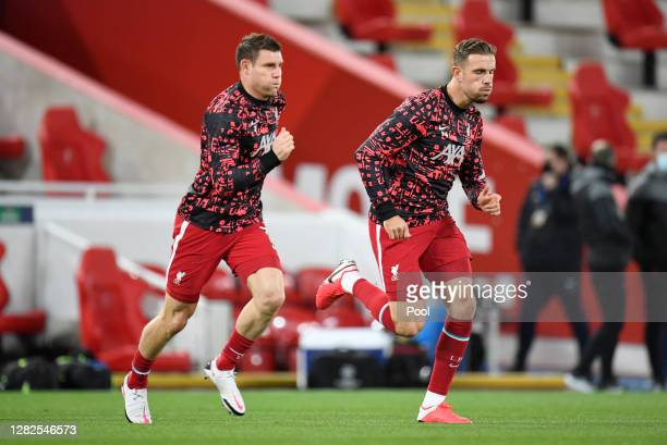 James Milner and Jordan Henderson of Liverpool FC warm up prior to the UEFA Champions League Group D stage match between Liverpool FC and FC...