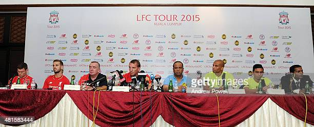 James Milner and Jordan Henderson of Liverpool Ian Ayre chief executive officer of Liverpool and Brendan Rodgers manager of Liveprool during a Press...