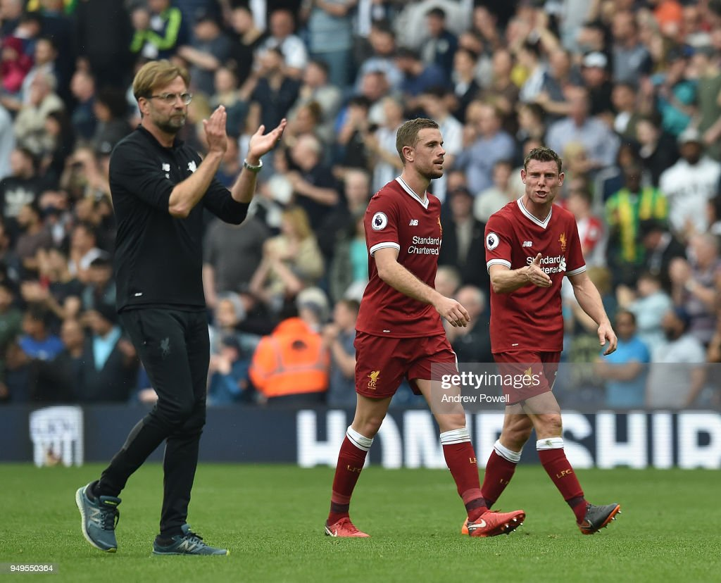 James Milner and Jordan Henderson of Liverpool with Jurgen Klopp at the end of the Premier League match between West Bromwich Albion and Liverpool at The Hawthorns on April 21, 2018 in West Bromwich, England.