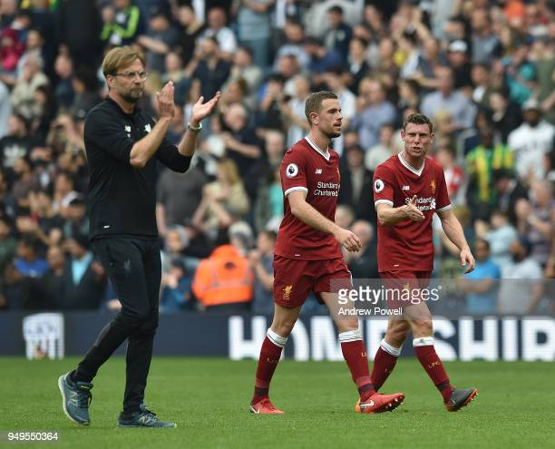 James Milner and Jordan Henderson of Liverpool with Jurgen Klopp at the end of the Premier League match between West Bromwich Albion and Liverpool at...