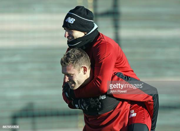 James Milner and Lazar Markovic of Liverpool during a training session at Melwood Training Ground on November 30 2017 in Liverpool England