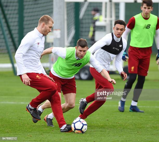 James Milner and Ragnar Klavan of Liverpool during a training session at Melwood Training Ground on April 17 2018 in Liverpool England