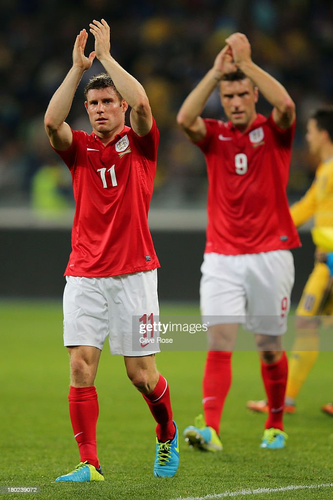 James Milner (L) and Ricky Lambert of England applaud the travelling fans following the 0-0 draw during the FIFA 2014 World Cup Qualifying Group H match between Ukraine and England at the Olympic Stadium on September 10, 2013 in Kiev, Ukraine.