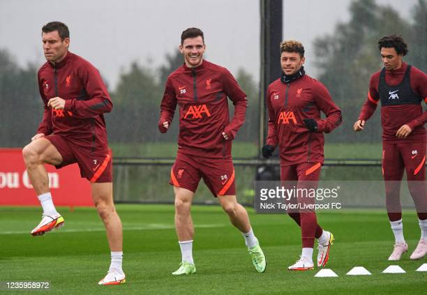 James Milner, Andrew Robertson, Alex Oxlade-Chamberlain and Trent Alexander-Arnold of Liverpool during a training session at AXA Training Centre on...