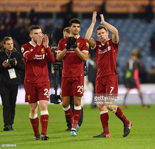 James Milner Andrew Robertson and Dominic Solanke of Liverpool showing their appreciation to the fans at the end of the Premier League match between...