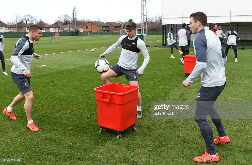 James Milner, Ben Woodburn and Andy Robertson of Liverpool during a
