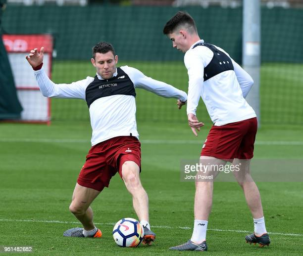 LIVERPOOL ENGLAND APRIL 26 James Milner Ben Woodburn of Liverpool during a training session at Melwood on April 26 2018 in Liverpool England