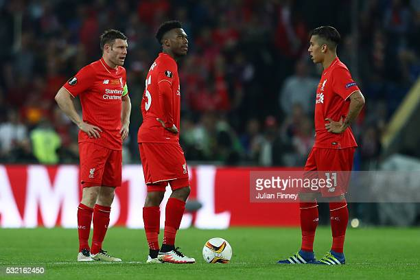 James Milner Daniel Sturridge and Roberto Firmino of Liverpool reacts after Sevilla's first goal during the UEFA Europa League Final match between...