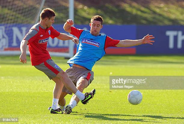 James Milner is challenged by Gary Cahill during the England training session at London Colney on October 13 2009 in St Albans England