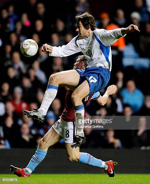 James Milner of Aston Villa battles with Matthew Lawrence of Crystal Palace during the FA Cup Fifth Round Replay match between Aston Villa and...