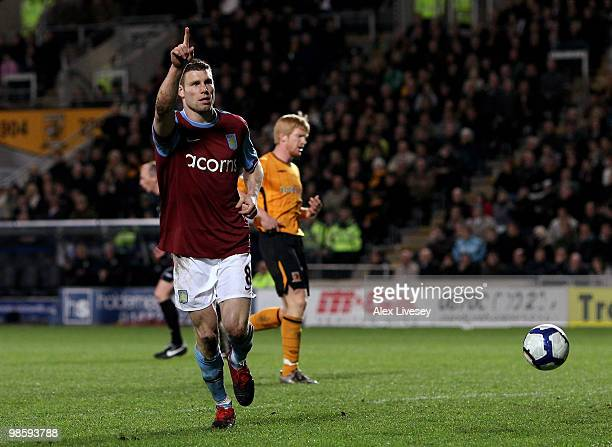 James Milner of Aston Villa celebrates after scoring the second goal from the penalty spot during the Barclays Premier League match between Hull City...