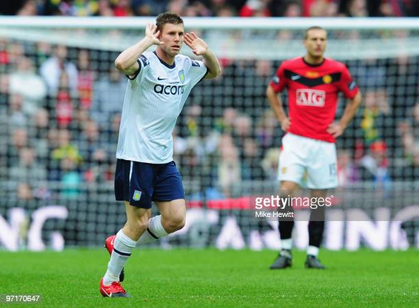 James Milner of Aston Villa celebrates as he scores their first goal from the penalty spot during the Carling Cup Final between Aston Villa and...