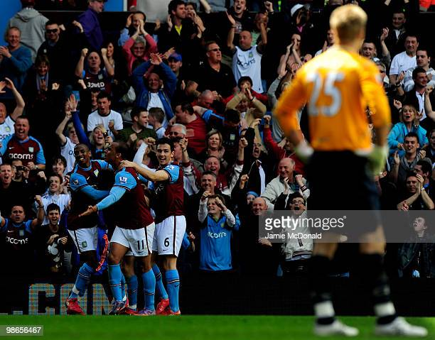 James Milner of Aston Villa celebrates scoring a penalty with Ashley Young Gabriel Agbonlahor and Stewart Downing during the Barclays Premiership...