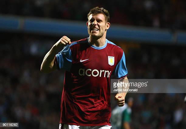 James Milner of Aston Villa celebrates scoring the opening goal from the penalty spot during the UEFA Europa League Play off second leg match between...