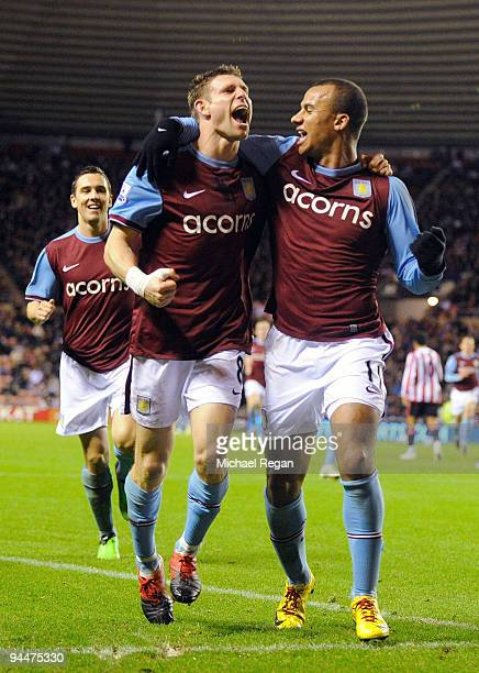 James Milner of Aston Villa celebrates scoring with Gabriel Agbonlahor during the Barclays Premier League match between Sunderland and Aston Villa at...