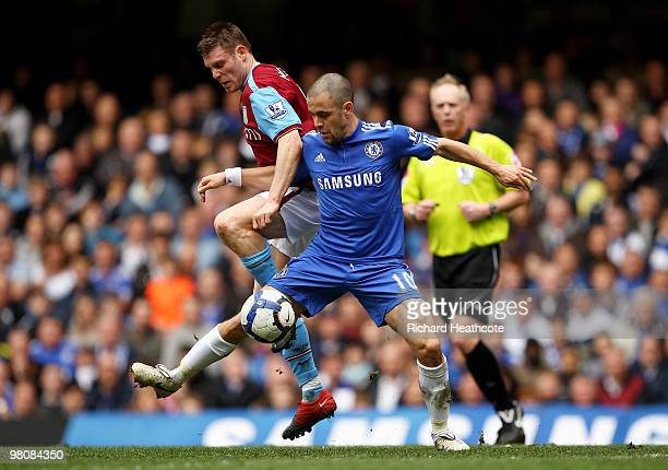 James Milner of Aston Villa challenges Joe Cole of Chelsea during the Barclays Premier League match between Chelsea and Aston Villa at Stamford...