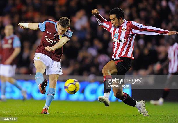 James Milner of Aston Villa evades Kieran Richardson of Sunderland to score his team's second goal during the Barclays Premier League match between...