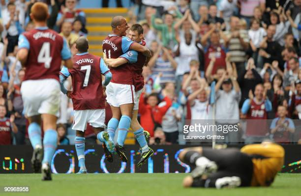 James Milner of Aston Villa is congratulated by Gabriel Agbonlahor after scoring from the spot during the Barclays Premier League match between Aston...