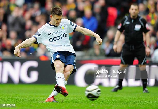 James Milner of Aston Villa scores their first goal from the penalty spot during the Carling Cup Final between Aston Villa and Manchester United at...