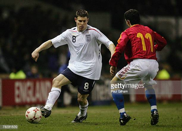 James Milner of England attempts to take the ball around Alejandro Alfaro Ligery of Spain during the International friendly match between England U21...